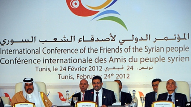 Tunisian foreign minister Rafik Abdessalem, center, opens the Conference on Syria in Tunis, Tunisia, February 24, 2012.