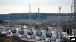FILE - A mobile gas turbine power plant works to provide electricity in Stroganovka village outside Simferopol, Crimea, Nov. 22, 2015.