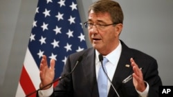 FILE - U.S. Defense Secretary Ash Carter, pictured at a Paris news conference in January, is in Abu Dhabi, a stop on a Mideast tour that will focus on the fight against Islamic State.