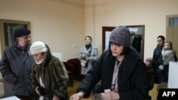 Croatian voters cast their ballots at the polling station in Zagreb, Croatia, January 22, 2012.