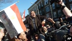 People celebrate President Mubarak's resignation on the streets of New York City, Feb 11, 2011