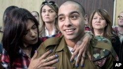 Israeli soldier Elor Azaria is embraced by his mother at the start of his sentencing hearing in Tel Aviv, Israel, Feb. 21, 2017.