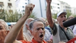 A pensioner shouts slogans during an anti-austerity protest in front of the EU headquarters in Athens, October 8, 2012.