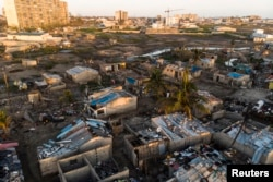 Debris and destroyed buildings which stood in the path of Cyclone Idai can be seen in this aerial photograph over the Praia Nova neighbourhood in Beira on April 1, 2019.