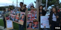 FILE - A crowd of Cambodian Americans protests the visit of Lt. Gen. Hun Manet in Long Beach, California, April 9, 2016.