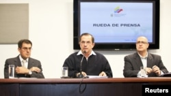 Ecuador's Minister of Foreign Affairs Ricardo Patino (C), attends a news conference regarding WikiLeaks' founder Julian Assange in Quito June 19, 2012.