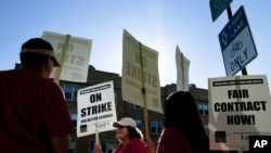 Public school teachers picket outside Amundsen High School in Chicago on the first day of a strike by the Chicago Teachers Union, Monday, Sept. 10, 2012.
