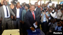 FILE- Frelimo presidential candidate Filipe Nyusi casts his ballot in the general election at a secondary school in Maputo, Oct. 15, 2014.