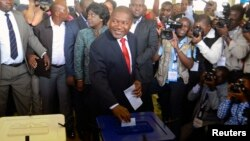 FILE - Filipe Nyusi casts his ballot in the general election at a secondary school in Maputo, Oct. 15, 2014.