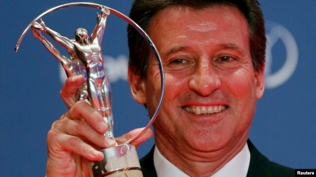 Sebastian Coe, chairman of the organizing committee for the London Olympics, poses with his Laureus Lifetime Achievement Award during the 2013 Laureus World Sports Awards, at Municipal Theater in Rio de Janeiro March 11, 2013.