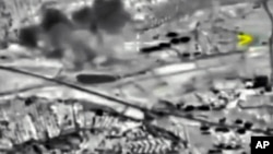 In this photo made from the footage taken from Russian Defense Ministry official web site on Oct. 2, 2015 a bomb explosion is seen in Syria.