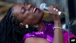 FILE - Sharon Jones of Sharon Jones and The Dap-Kings performs during the Bonnaroo Music and Arts Festival in Manchester, Tenn., June 8, 2012.