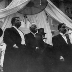 Theodore Roosevelt, left, stands with Manuel Amador, center
