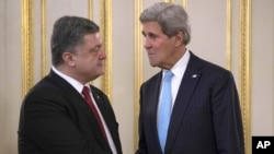 Ukrainian President Petro Poroshenko, left, shakes hands with U.S. Secretary of State John Kerry during a meeting in Kyiv, Feb. 5, 2015.
