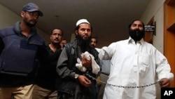 Mullah Abdul Ghani Baradar, saat ditangkap di Karachi, 18 Februari 2010 (Foto: dok).