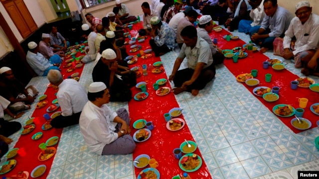 Muslims pray before iftar, or the breaking of fast meal, during the holy fasting month of Ramadan at a mosque, July 1, 2014.