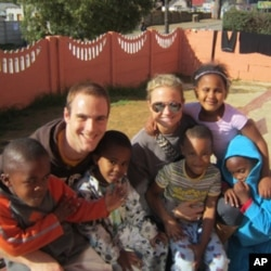 Study abroad students Ben Valerio and Hillary Kinsey at the Siyazingcy Creche, a daycare center in South Africa.