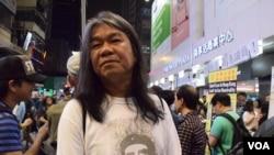 Nhà lập pháp thân dân chủ Hong Kong Lương Quốc Hùng còn có biệt danh là 'Tóc dài'.