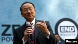 """FILE - World Bank Group President Jim Yong Kim addresses the crowd at a program for the """"EndPoverty 2030"""" campaign in Washington."""