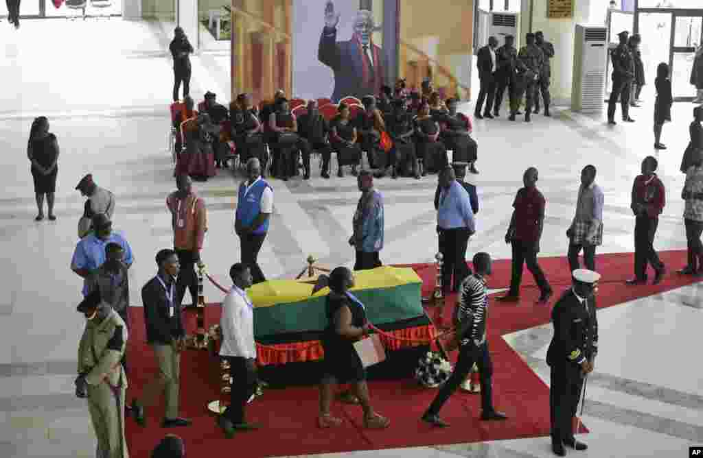 Members of the public pay their respects as the coffin of former U.N. Secretary-General Kofi Annan lies in state at the Accra International Conference Center in Ghana.