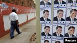 FILE - Election posters of the opposition Renamo party in Mozambique's capital, Maputo, Oct., 2009.