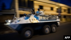 A United Nations armored personnel carrier patrols through the city of Goma following the sound of shell fire and gunshots, November 19, 2012.