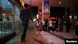 Blood is seen on the ground outside after a knife attack at Kunming railway station, Yunnan province, March 1, 2014.
