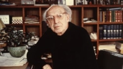 Aaron Copland at home in his library