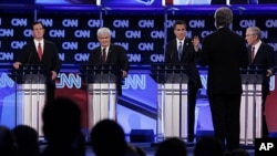 Republican presidential candidates, from left, former Pennsylvania Sen. Rick Santorum, former House Speaker Newt Gingrich, former Massachusetts Gov. Mitt Romney and Rep. Ron Paul, R-Texas, look toward moderator Wolf Blitzer of CNN as they participate in t