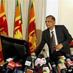 Sri Lanka's External Affairs Minister Gamini Peiris leaves a media briefing in Colombo, Apr 21 2011