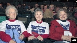 Katie McCann, and Bev Stogdill (L-R) from Johnston, Iowa, await the beginning of the Iowa Faith & Freedom Coalition's Spring Event at Point of Grace Church in Waukee, Iowa. Five possible Republican White House hopefuls courted conservative voters in Iowa,