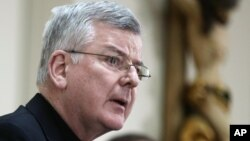FILE - Archbishop John Nienstedt addresses a news conference, Jan. 16, 2015, in St. Paul, Minnesota.