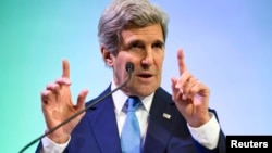 U.S. Secretary of State John Kerry gestures while speaking about climate change in Jakarta, Feb. 16, 2014.