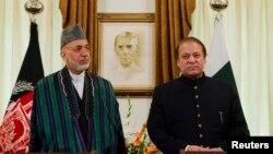 阿富汗總統卡爾扎伊(左)在巴基斯坦的伊斯蘭堡會晤了巴基斯坦總理謝里夫(右).
