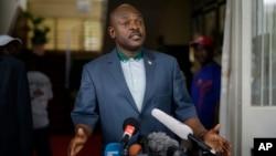FILE - President Pierre Nkurunziza makes a brief statement at the presidential palace in Bujumbura, Burundi, May 17, 2015.