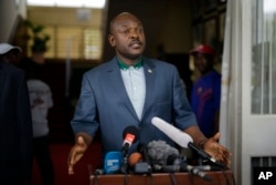 FILE - President Pierre Nkurunziza makes a brief statement at the presidential palace in Bujumbura, Burundi, May 17, 2015.