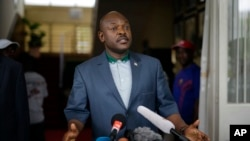 FILE - Burndian President Pierre Nkurunziza makes brief statement at presidential palace, Bujumbura, May 17, 2015.