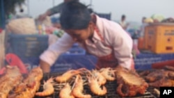 Grilled food stall in Vientiane that sells aqua-cultured Tilapia fish