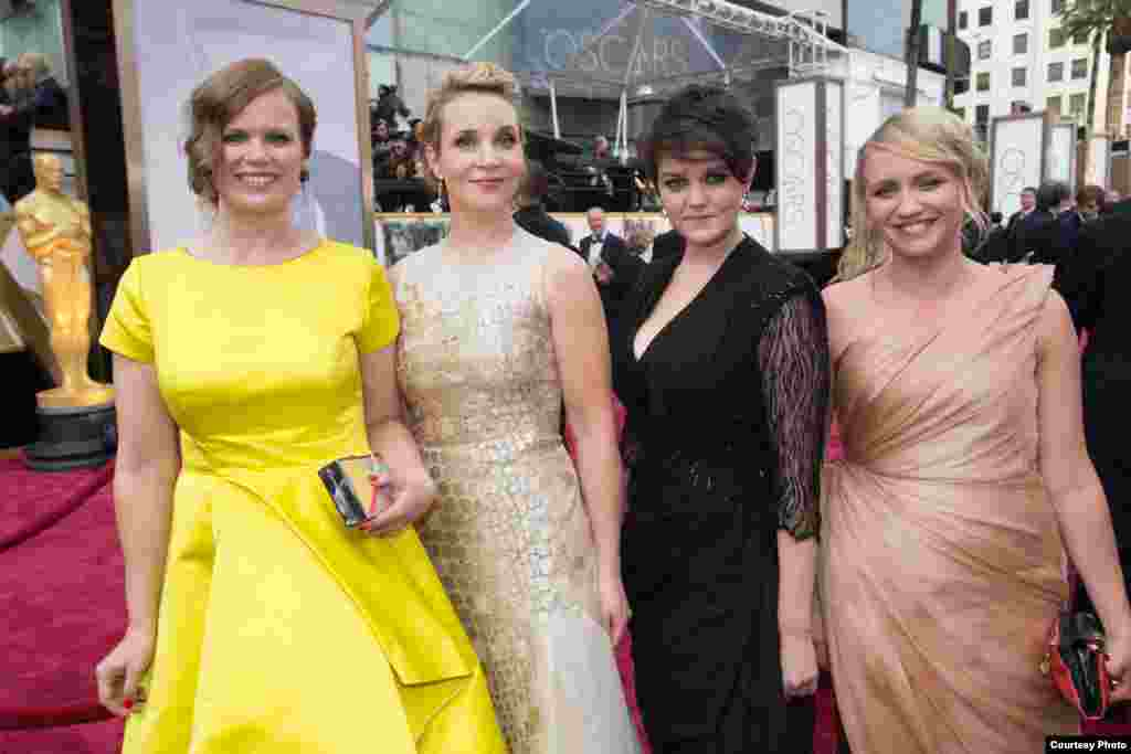 Oscar®-nominees Selma Vilhunen (L) and Kirsikka Saari (2nd from L) and guests arrive for the live ABC Telecast of The 86th Oscars® on March 2, 2014 in Hollywood, CA. (Photo courtesy AMPAS).