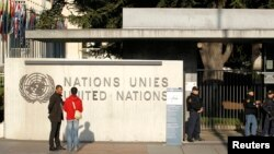 FILE - United Nations security officers stand guard outside the U.N. European headquarters in Geneva, Switzerland, Dec. 10, 2015.