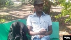 FILE: Political activist and former journalist Itai Dzamara staging a sit-in in Harare's Africa Unity Square on Tuesday, October 21, 2014. (Photo: By Frank Chikowore)