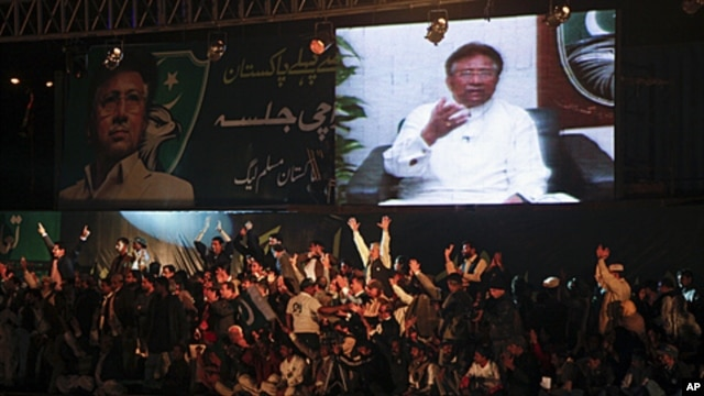 Leaders and supporters of the political party All Pakistan Muslim League surround a screen broadcasting a speech by their party president Pervez Musharraf from Dubai via video link, in Karachi, January 8, 2012.