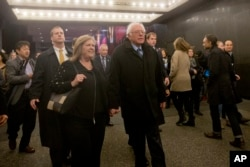"Democratic presidential candidate Bernie Sanders and his wife, Jane, walk in Times Square on their way to see the Broadway show ""Hamilton"" in New York, April 8, 2016."
