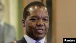 FILE: Zimbabwean central bank governor John Mangudya delivers his 2016 Monetary Policy statement in Harare, Feb. 4, 2016.
