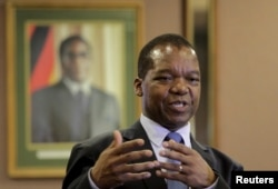 FILE - Zimbabwean Central Bank Governor John Mangudya delivers his 2016 Monetary Policy statement in Harare, Feb. 4, 2016.