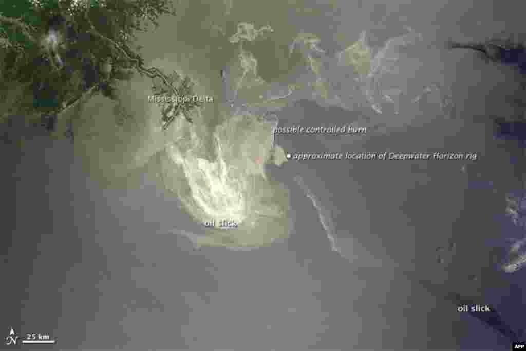 Sunlight illuminates the lingering oil slick off the Mississippi Delta, 24 May 2010. (NASA Image)
