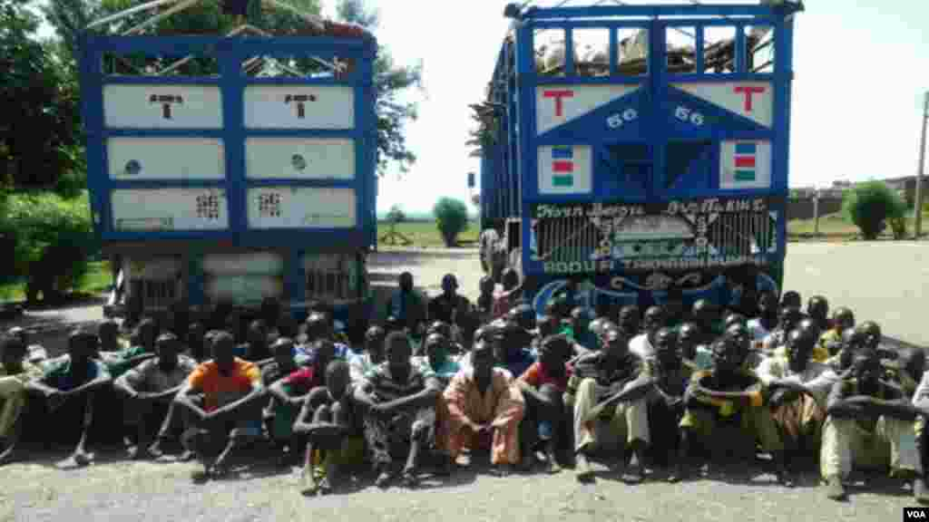 A group of Boko Haram fighters who recently surrendered with their equipment to the Nigerian military near Maiduguri.
