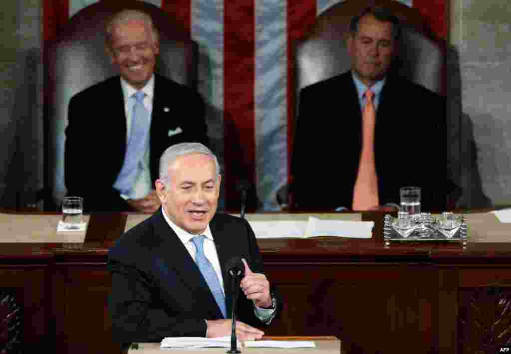May 24: Israel's Prime Minister Benjamin Netanyahu addresses a joint meeting of Congress in front of U.S. Vice President Joe Biden (L) and House Speaker John Boehner. (Reuters)