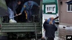 桑迪飓风过后,新泽西州的一名妇女离开遭到水淹的家,被扶上国民警卫队的军车。(2012年10月30日)