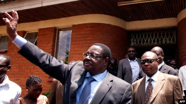 FILE - A November 14, 2013 photo outside Lilongwe's High Court shows Malawi's Democratic Progressive Party President and winner of the presidential election Peter Mutharika (C), as he waves to his supporters.